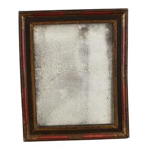 Espejo en madera tallada y policromada del siglo XVIII