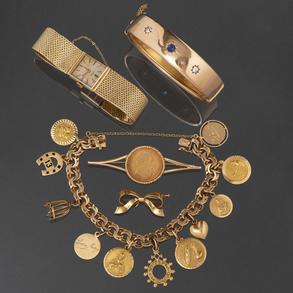 Miscelánea de piezas de oro amarillo de 18 Kt. y moneda de oro de 22 Kt.