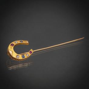 Alfiler en forma de herradura en oro amarillo de 18 kt.
