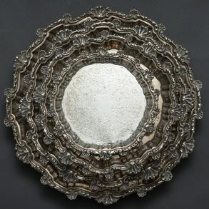 Conjunto de cuatro salvillas en plata española punzonada. Siglo XX.