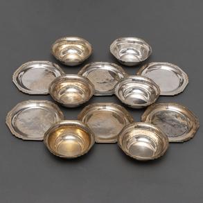 Conjunto de seis platillos de pan y seis lavafrutas en plata Americana Sterling.