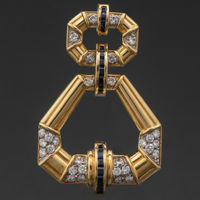Colgante articulado en oro amarillo de 18 Kt con diamantes talla brillante y zafiros