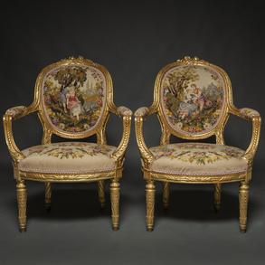 Pareja de butacas francesas estilo luís XVI en madera tallada y dorada. Trabajo Francés, Último tercio del siglo XIX