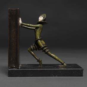 Apoyalibros realizado en bronce y marfil. Siglo XX