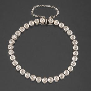 Pulsera Riviere en oro blanco con diamantes talla brillante en chatón